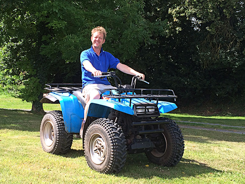 John Joseph of Trecorras farm on a quad bike
